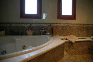 The big whirlpool bath in the master bedroom's bathroom