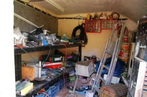 The inside of the tool shed at the back yard