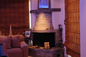 The stone fireplace in the playroom