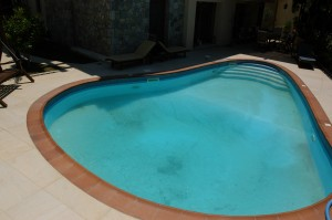 A great shaped big pool is located at the front yard