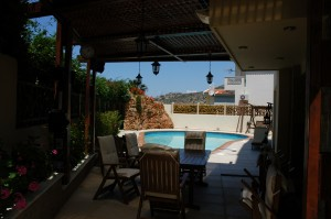 A big dining area next to the pool